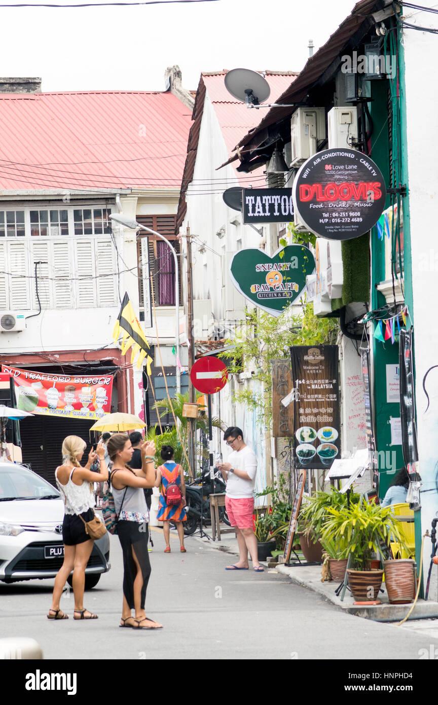 Love Lane scene with tourists, Georgetown, Penang, Malaysia - Stock Image