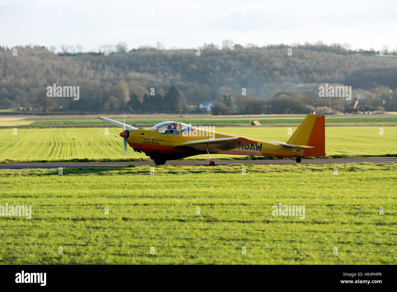 Scheibe SF-25-C Falke taxiing at Wellesbourne Airfield, Warwickshire, UK (G-KGAW) - Stock Image