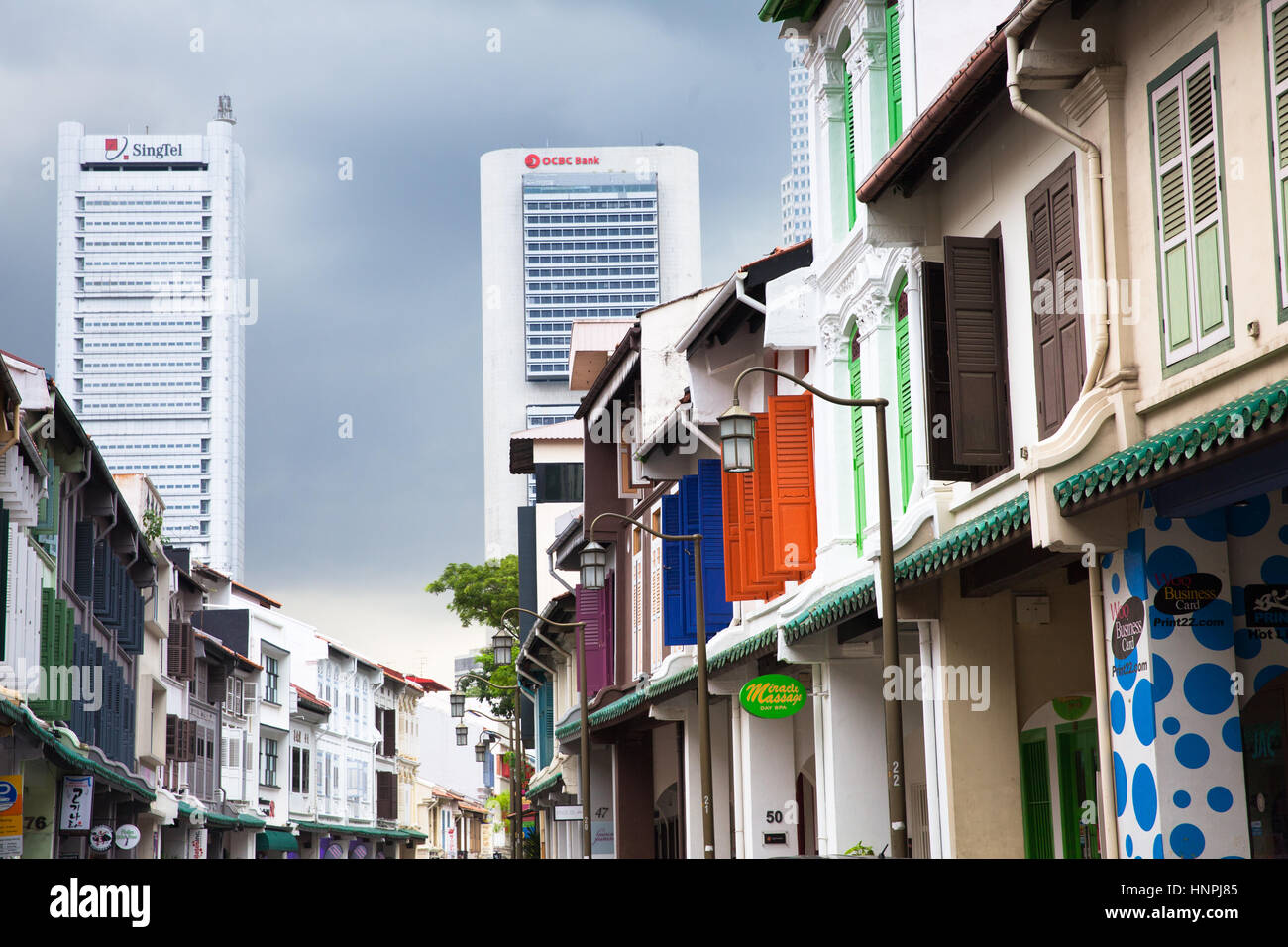 Singapore - July 11, 2013: Daytime view of the historical buildings in Chinatown district of Singapore with modern - Stock Image