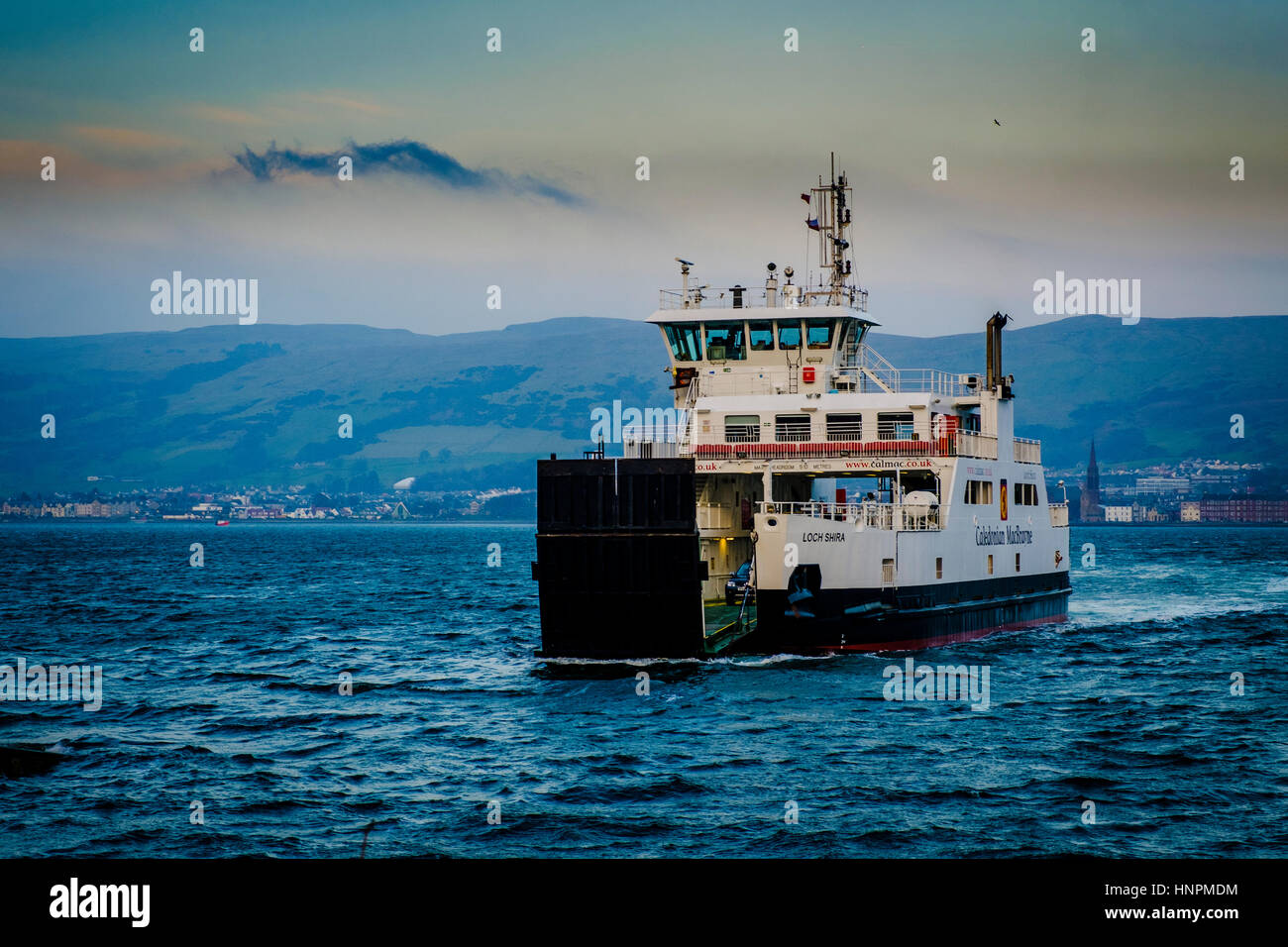 The Calmac ferry 'Loch Shira' making the short crossing from Largs on the Scottish mainland to the island - Stock Image