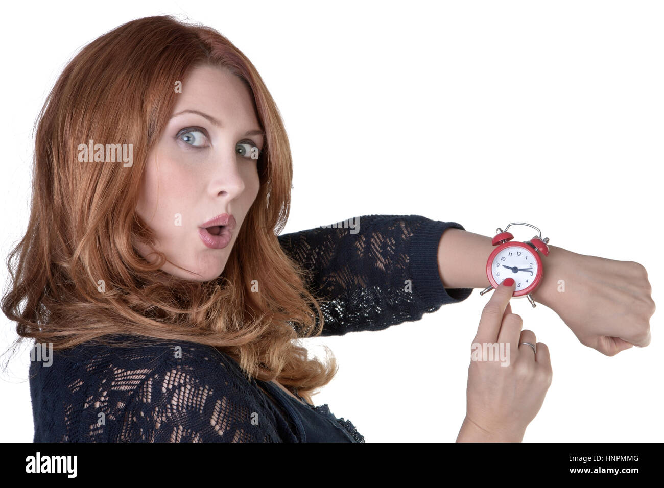 woman looking at her watch running late - Stock Image