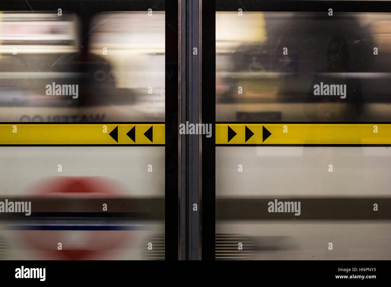 London Underground train rushes past Waterloo Station's Jubilee Line. - Stock Image