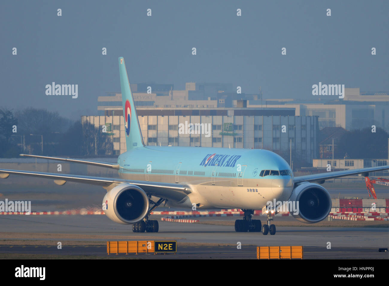Korean Air Boeing 777-3B5ER HL8208 taxiing in after arrival at London Heathrow Airport. Space for copy - Stock Image