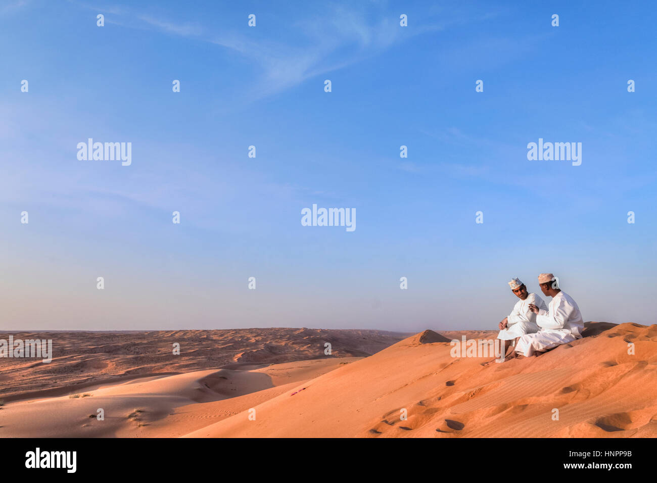 two Omani men in Wahiba Sands, Oman, Middle East, Asia - Stock Image