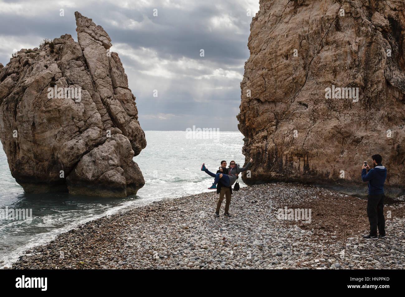 Tourists taking photos at the Birthplace of Aphrodite (Petra tou Romiou), near Paphos, Cyprus - Stock Image