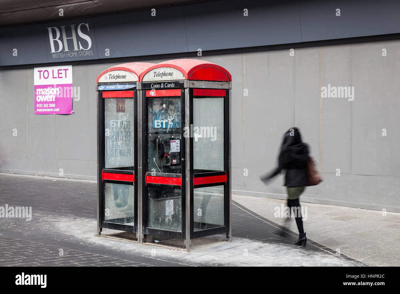 BT KX100 Disused, dirty, redundant red BT Telephone Boxes outside BHS in Liverpool City centre, Merseyside, UK - Stock Image