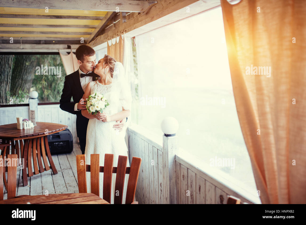 Bride and groom in the cafe an outdoor  - Stock Image