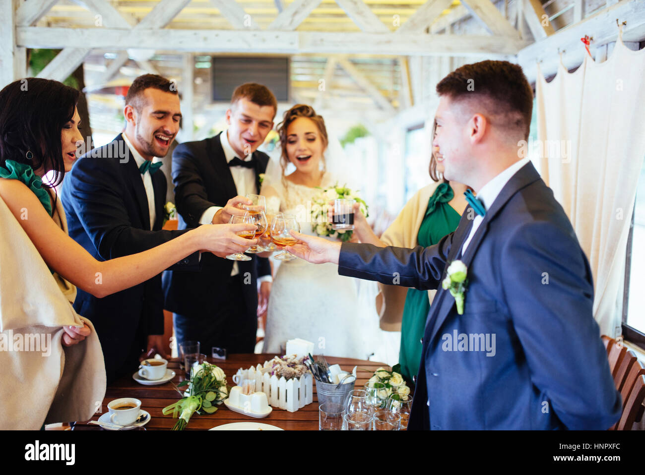 brides wedding day with friends in a cafe - Stock Image
