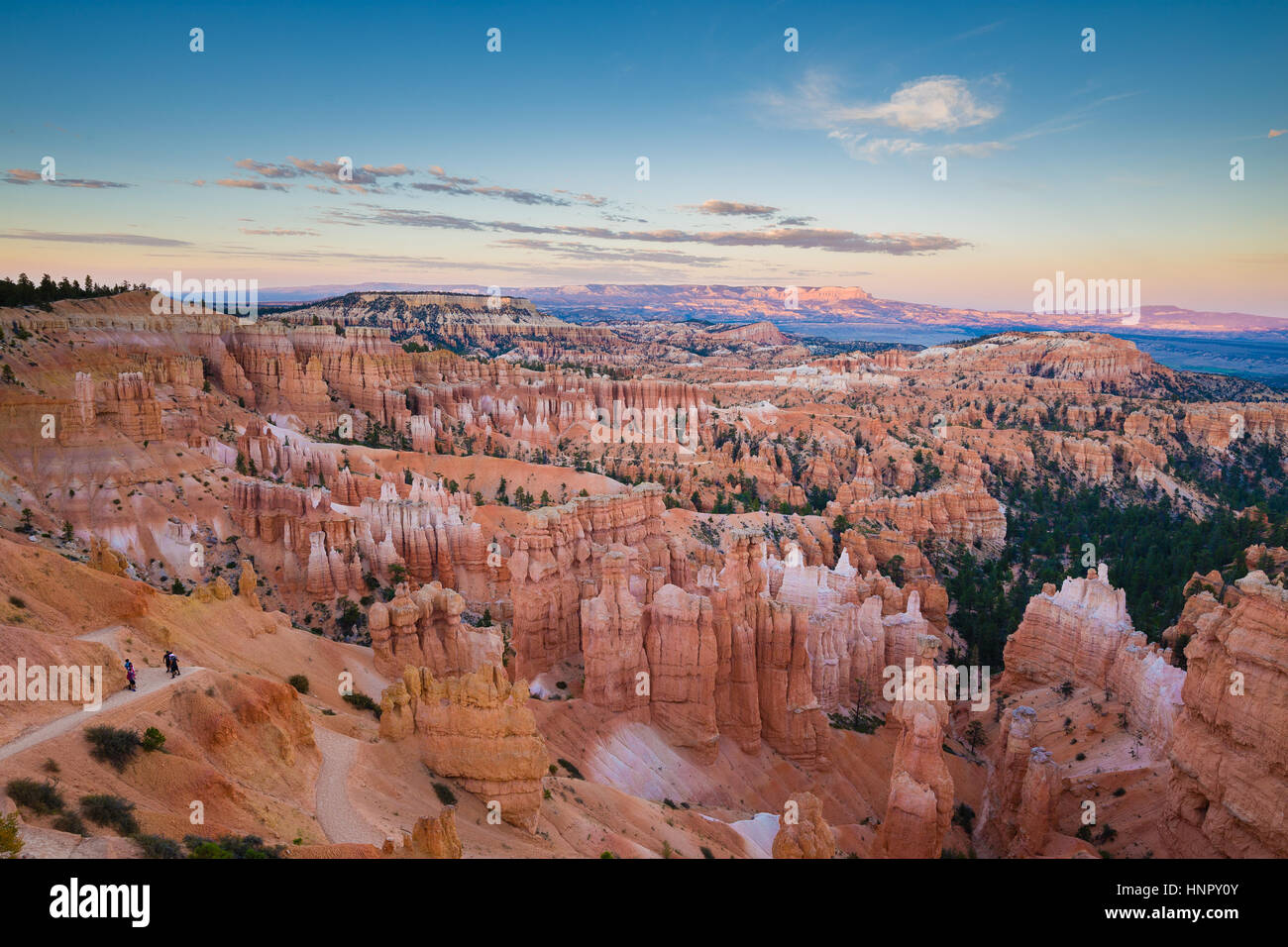 Classic view of Bryce Canyon National Park in beautiful golden evening light at sunset with blue sky and dramatic - Stock Image