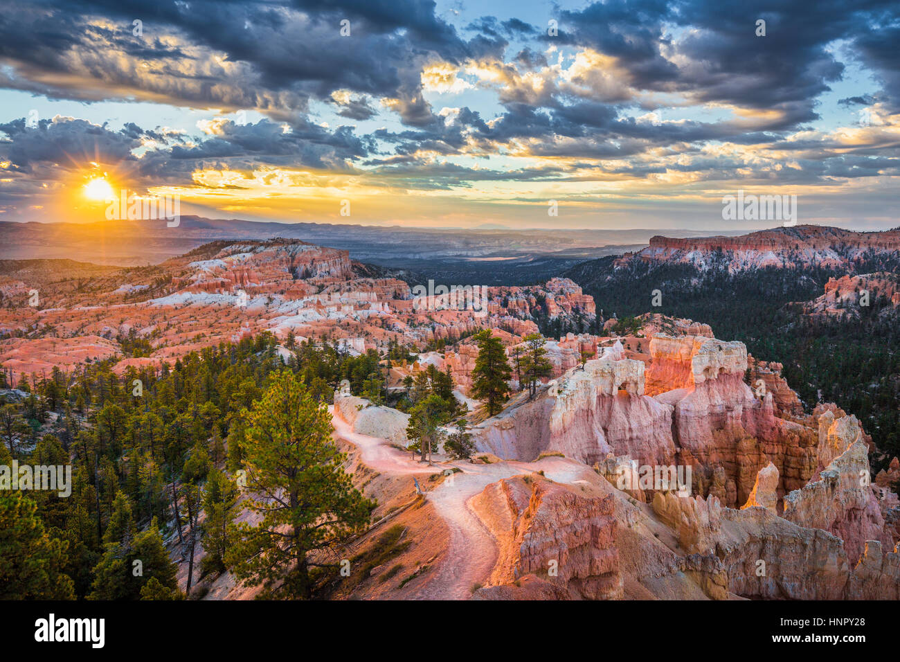 Classic view of Bryce Canyon National Park in beautiful golden morning light at sunrise with blue sky and dramatic - Stock Image
