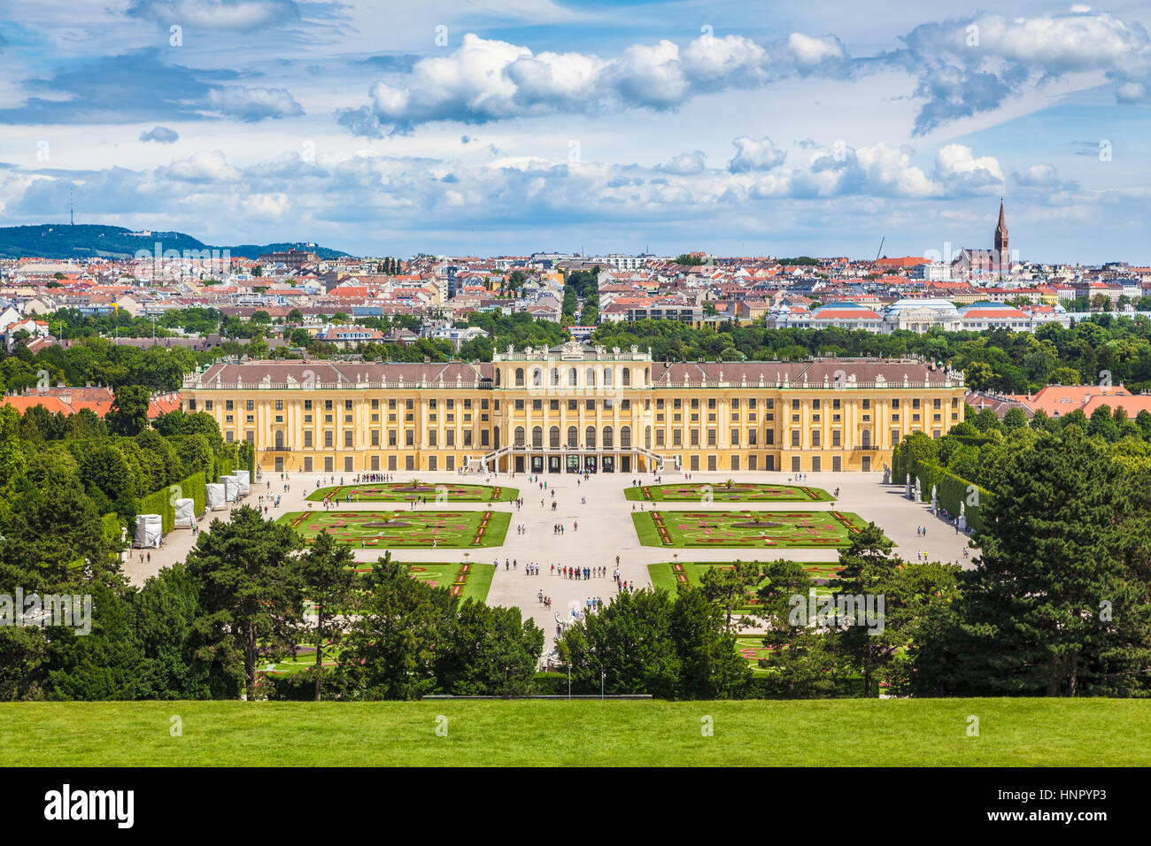 Classic view of famous Schonbrunn Palace with scenic Great Parterre garden on a beautiful sunny day with blue sky - Stock Image