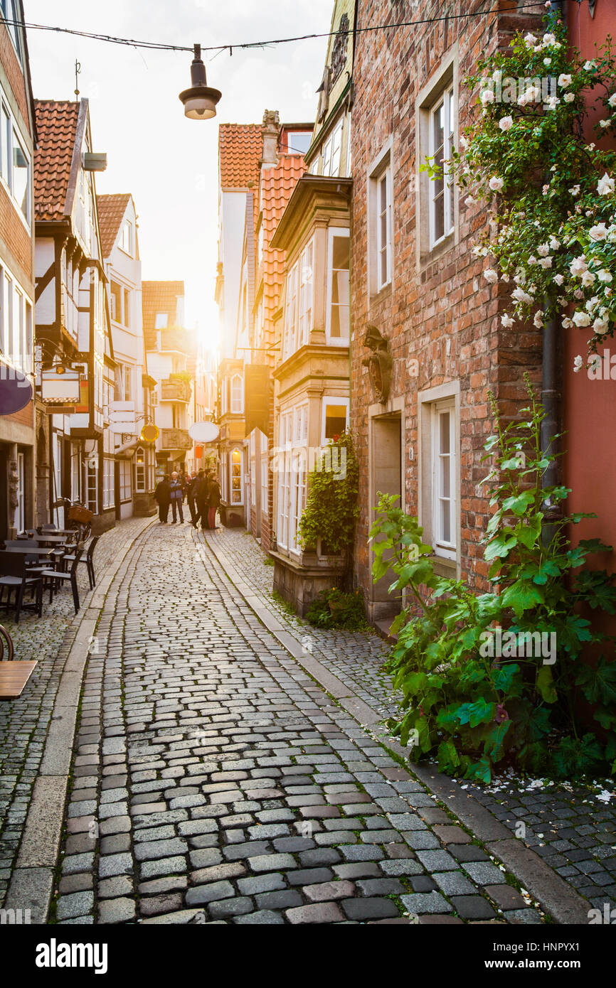 Vertical view of an old town in Europe in beautiful golden evening light at sunset in summer with pastel toned retro - Stock Image