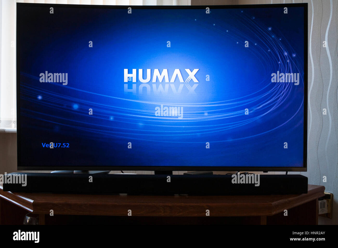 Ultra HD LED Smart TV linking to a Humax set top box for recording Freesat programmes for later viewing of programmes - Stock Image