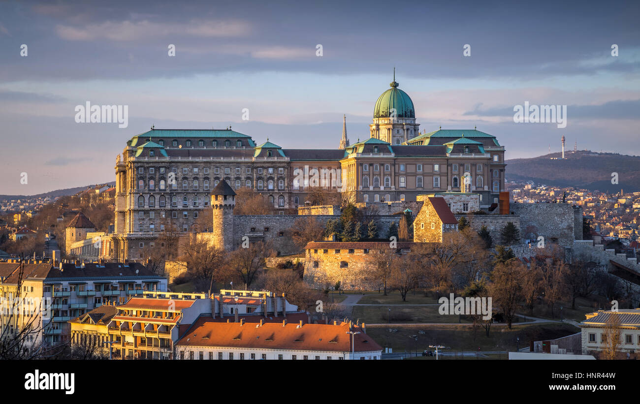 Budapest, Hungary - The famous Buda Castle (Royal Palace), St. Matthias Church and Fishermen's Bastion at sunset Stock Photo
