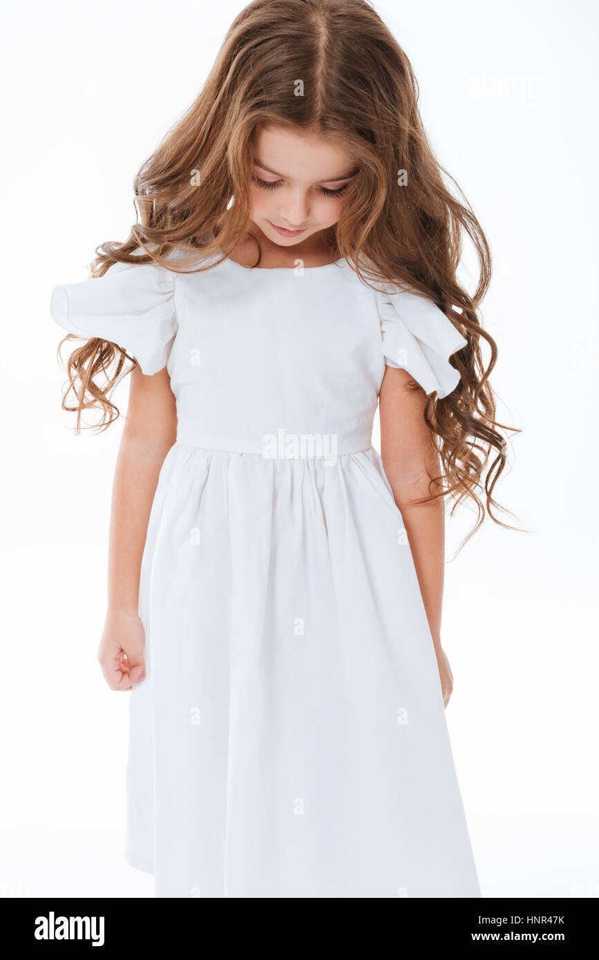 Sad Cute Little Girl With Long Curly Hair Standing And Looking Down