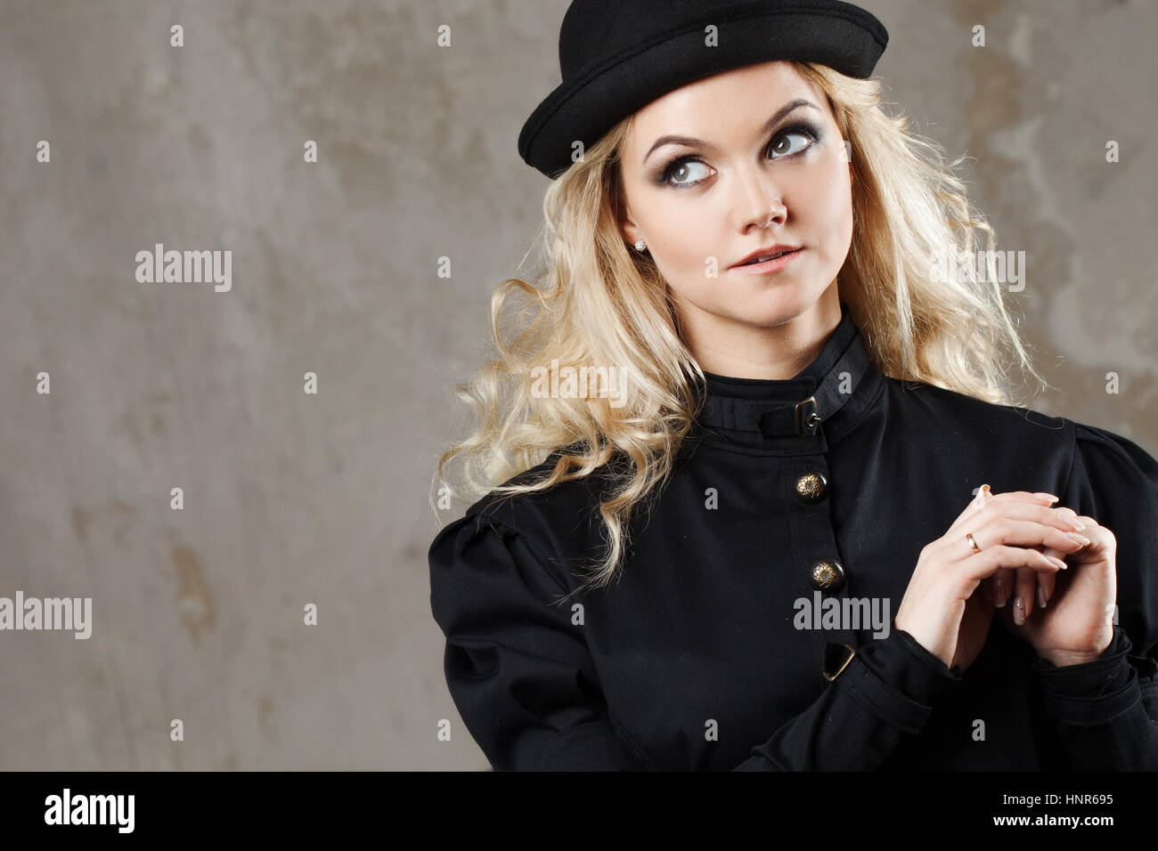 Portrait of a beautiful steampunk woman hat-bowler hat over grunge  background. 62b96e1ba60d