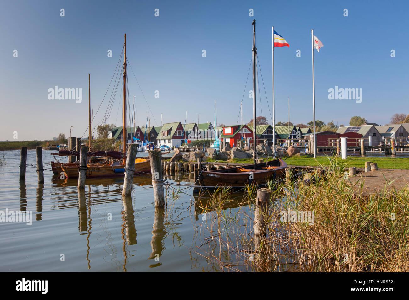 Sailing boats and boathouses at the harbour of Althagen at Fischland-Darß-Zingst, Mecklenburg-Vorpommern, Germany - Stock Image