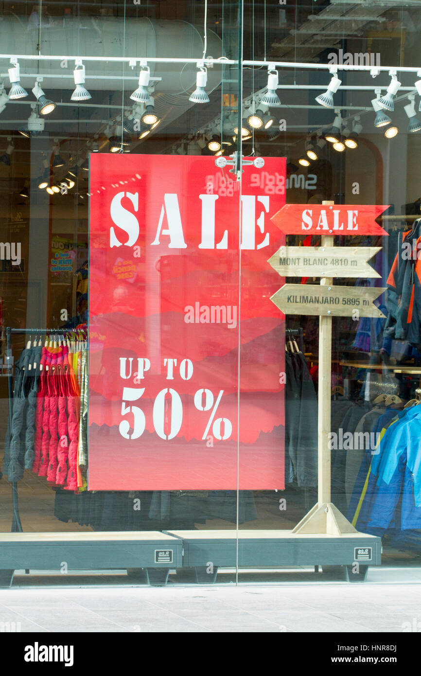 Sale signs in shop windows in city centre retail outlets - Stock Image