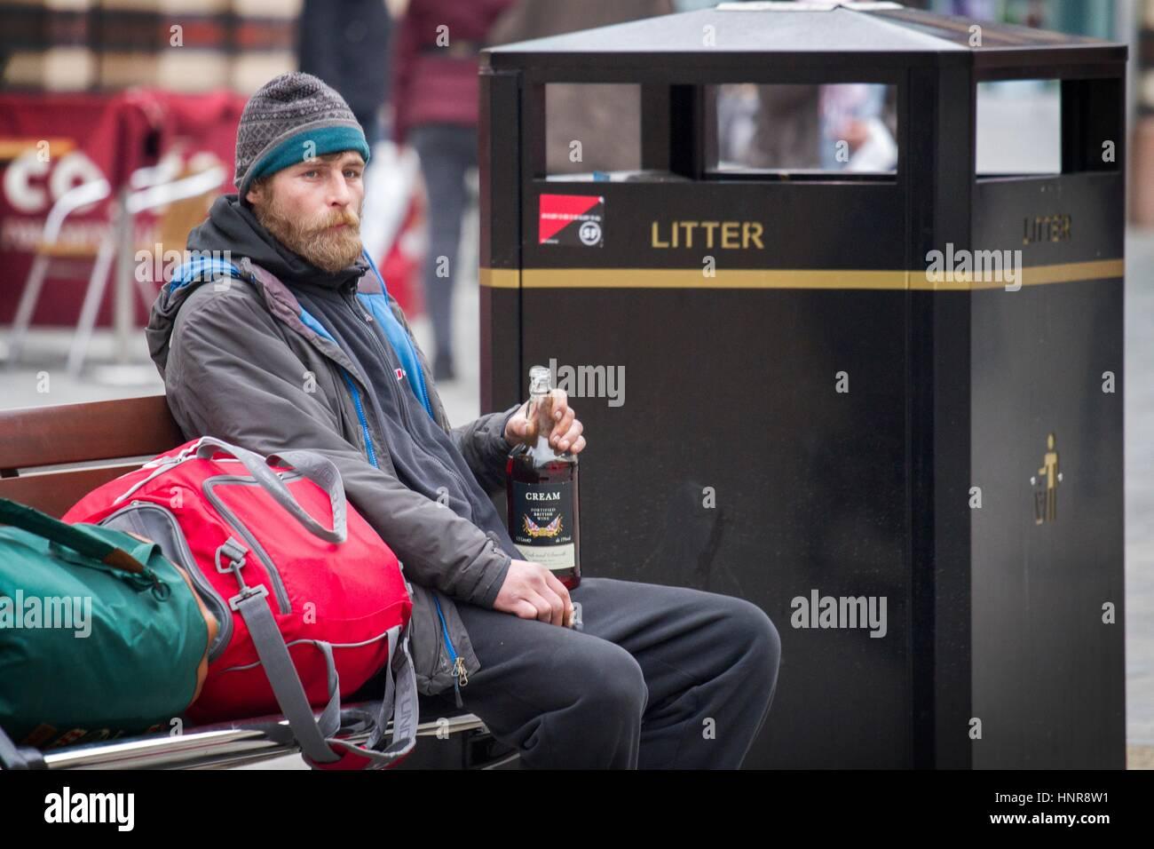 homeless homelessness sleeping rough beg beggar begging hungry cold winter sad donation money tramp hobo poor poverty - Stock Image