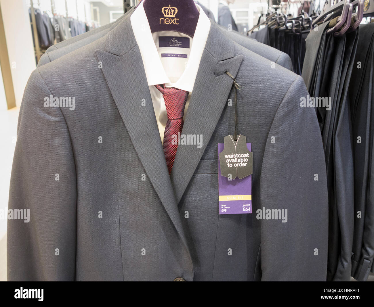 Suit in Next store. UK - Stock Image