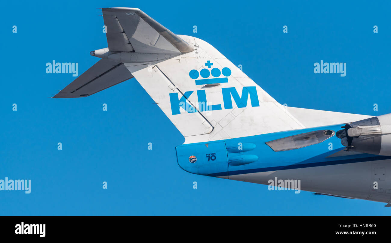 Airplane or aeroplane tail wing from KLM  Commercial aviation is a massive industry involving the transport of passengers - Stock Image