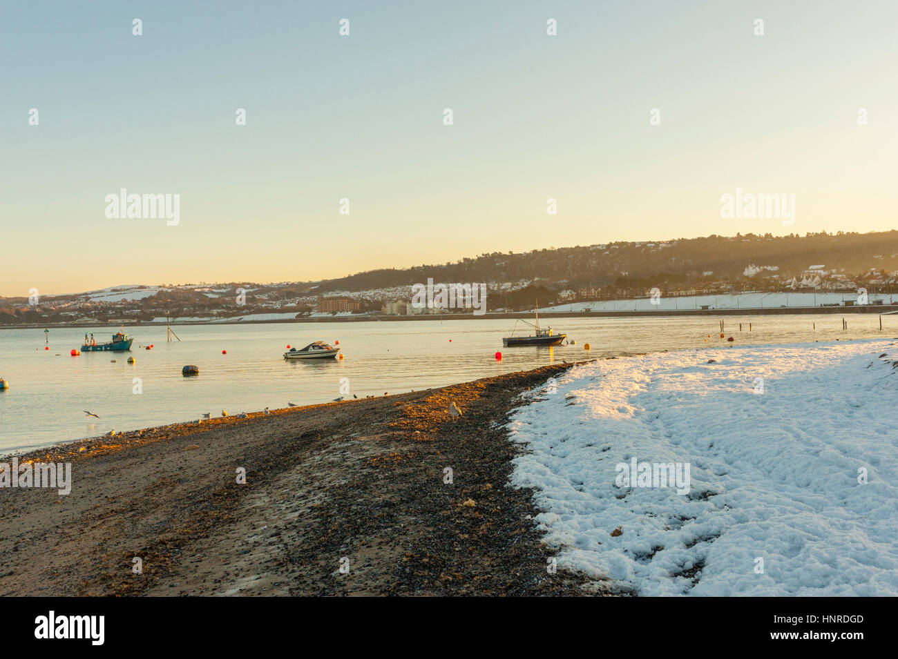 The beach at Rhos on sea covered in snow after a winter blizzard Stock Photo
