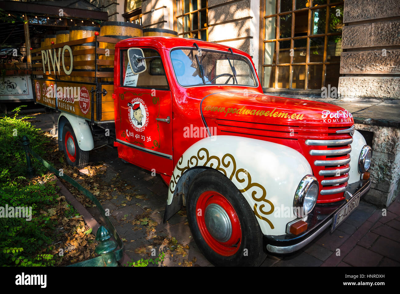 Vintage beer truck that stands near one of the most famous beer halls in Krakow Poland. Piwo is Polish for Beer - Stock Image