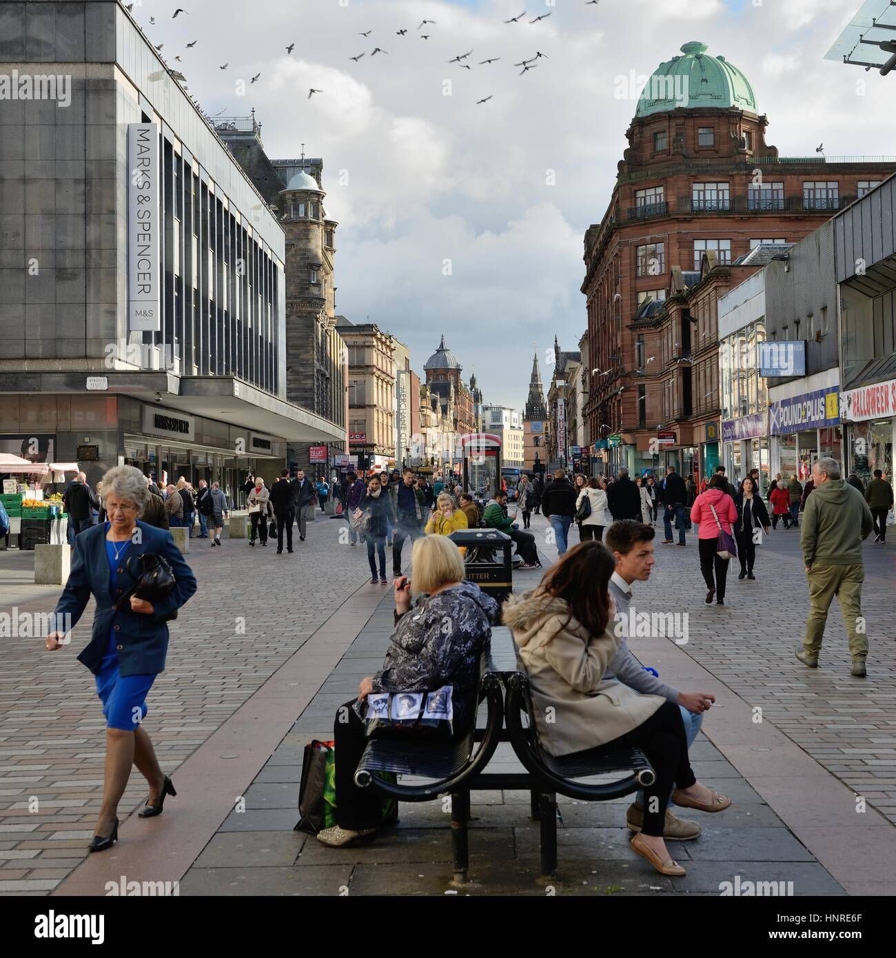 Looking east on a busy Argyle Street pedestrian precinct in Glasgow city centre, Scotland, UK - Stock Image