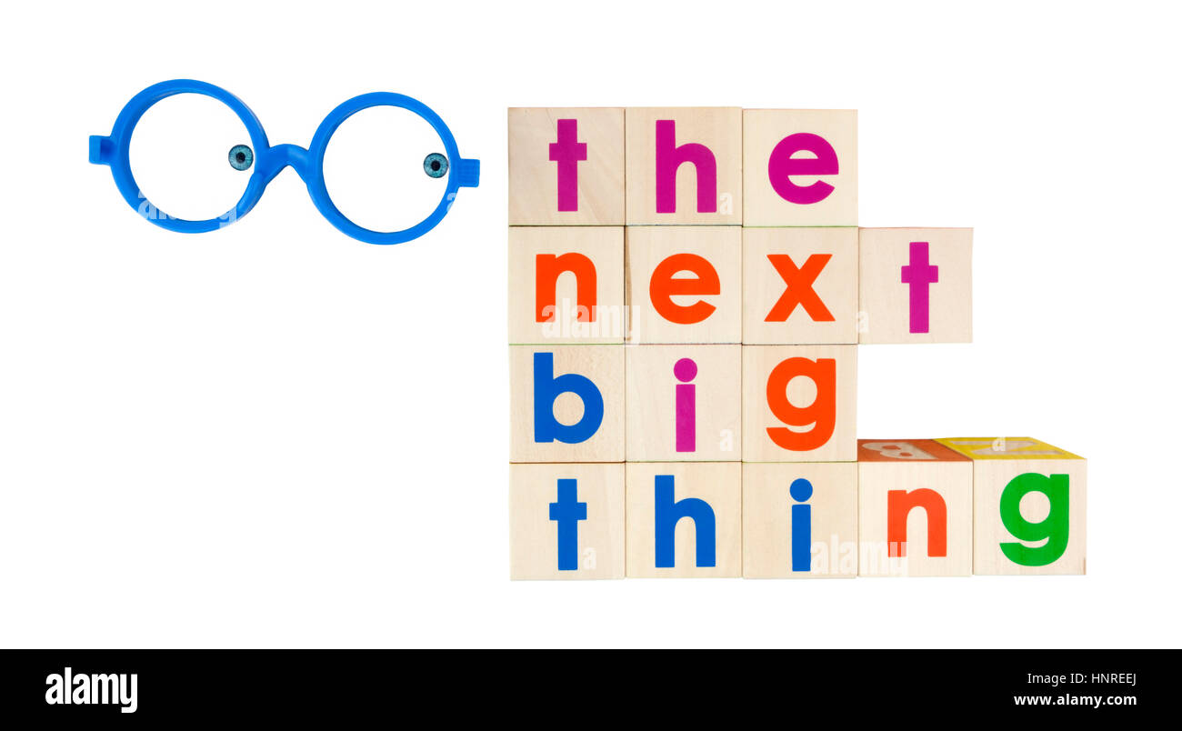 THE NEXT BIG THING concept in toy blocks with googly eyes. Isolated. - Stock Image