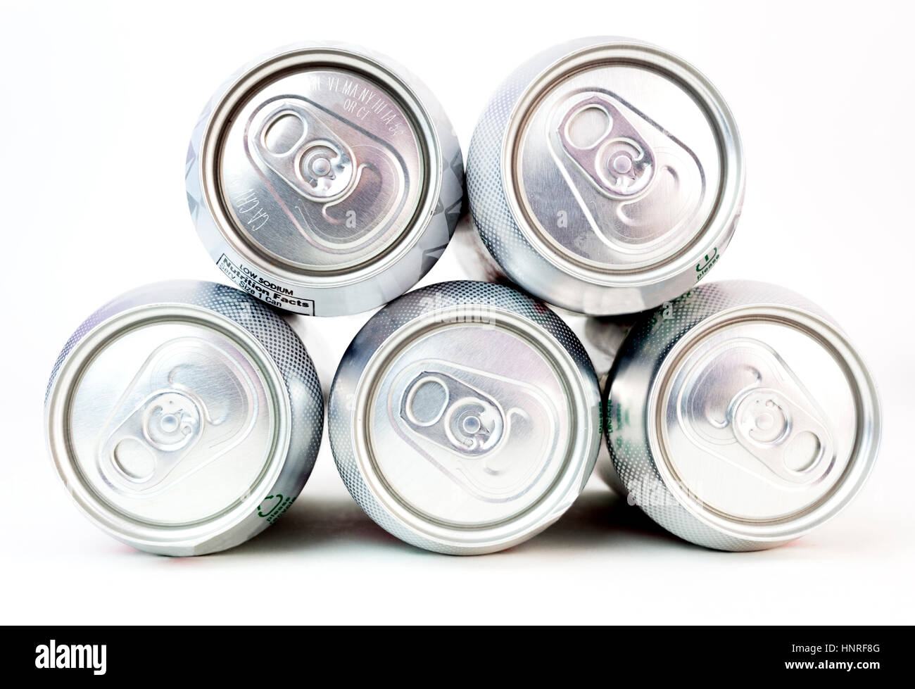 Front view of tops of aluminum beverage cans with pull tab tops. - Stock Image