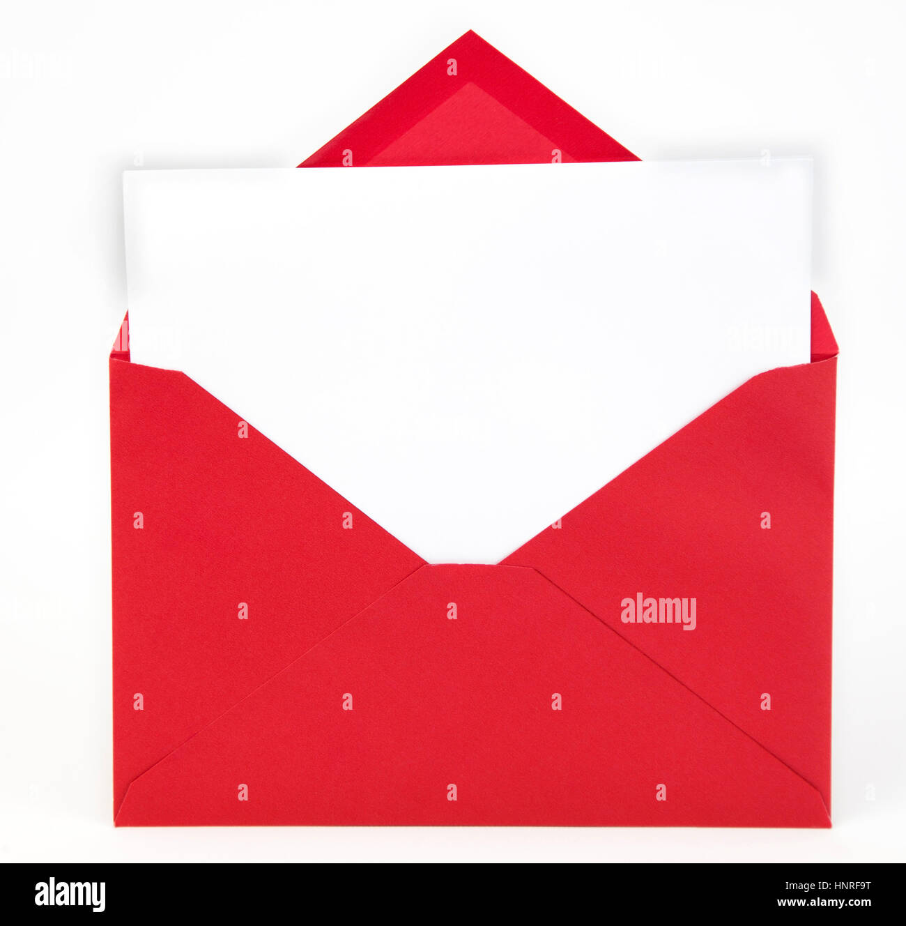 open flap on red invitation envelope with blank card with copy space