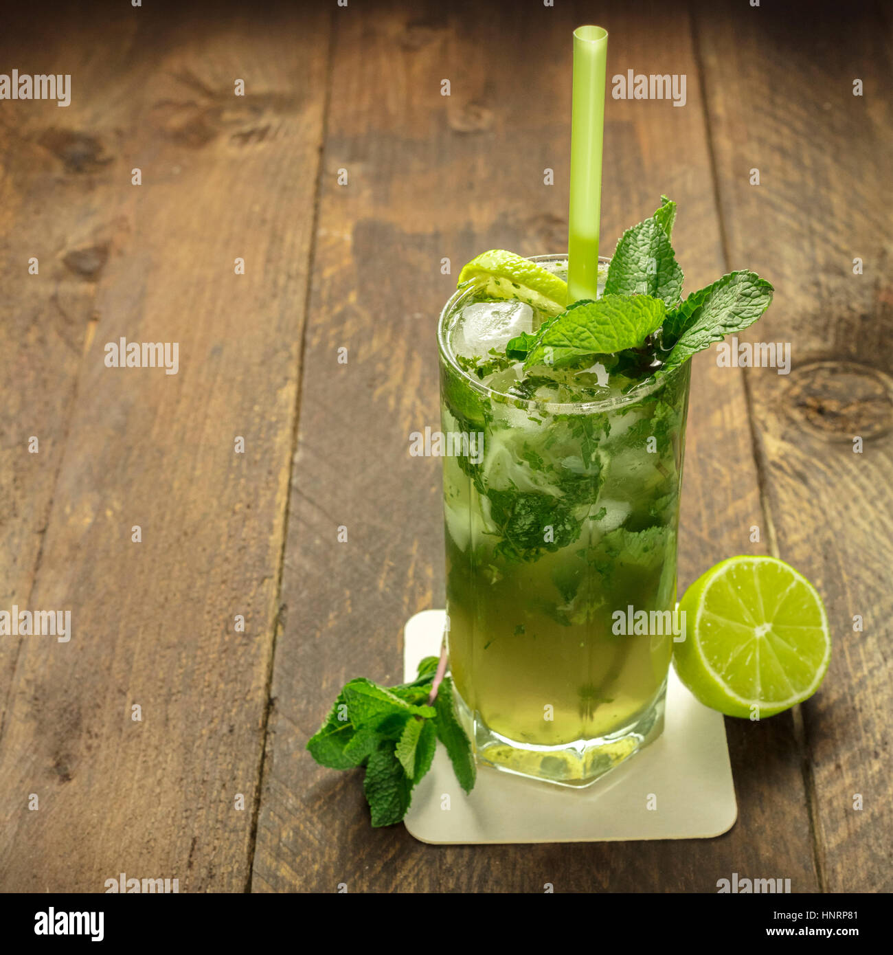 Mojito cocktail with mint leaves and lime - Stock Image
