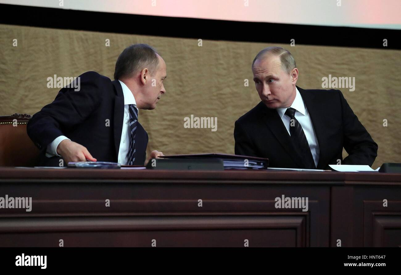Moscow, Russia. 16th Feb, 2017. Russian President Vladimir Putin listens to Director of the FSB Alexander Bortnikov, - Stock Image