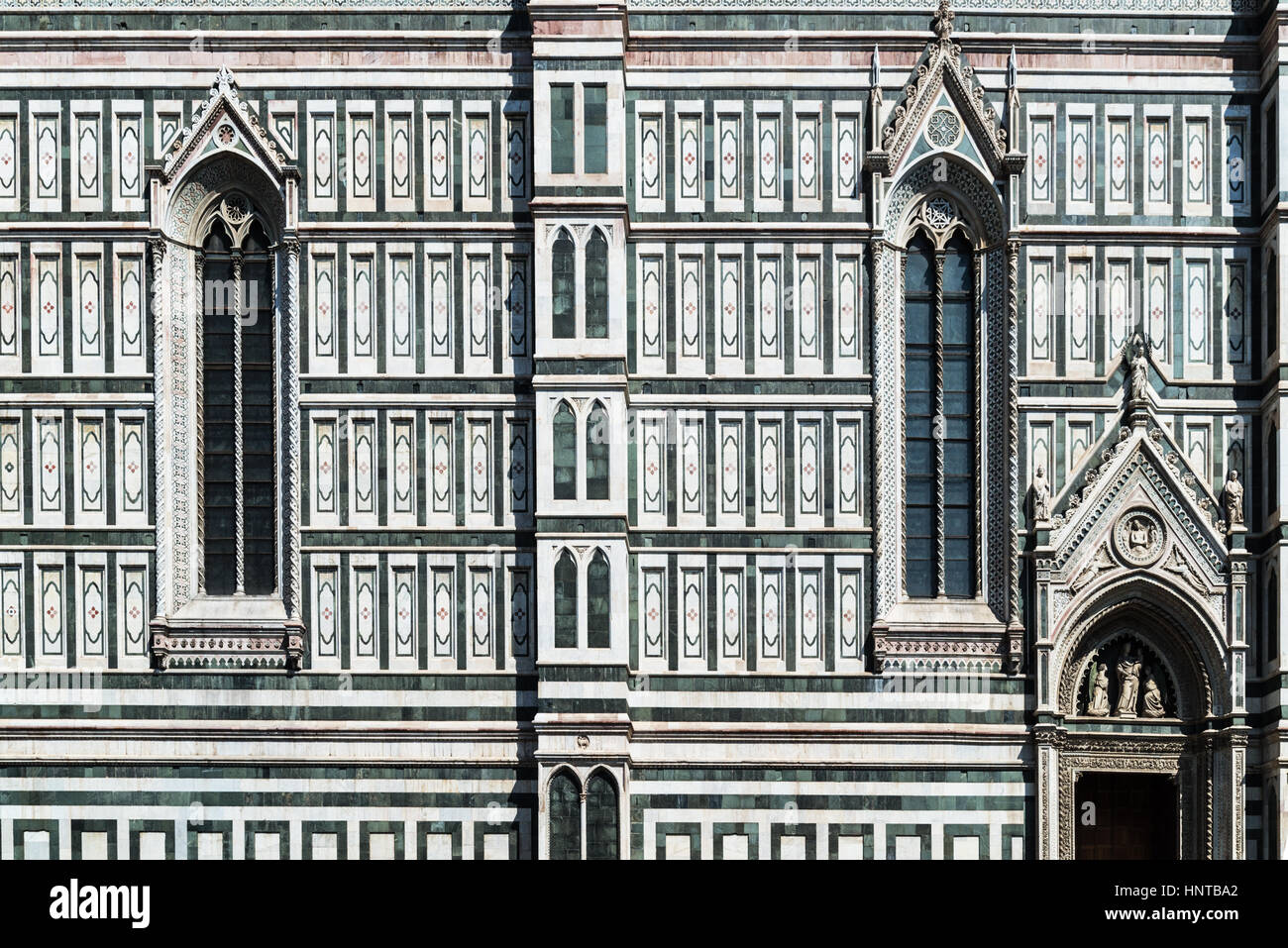 Gothic window - a detail of the facade of the Duomo cathedral in Florence, Italy - Stock Image