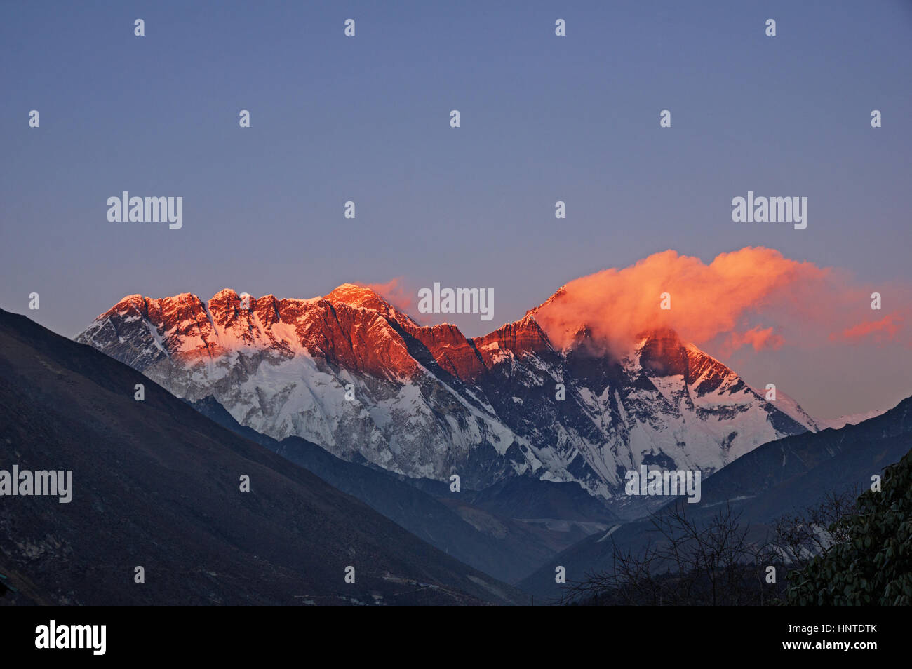 last light on Mount Everest Nuptse and Lhotse with a few clouds viewed from Tengboche Stock Photo