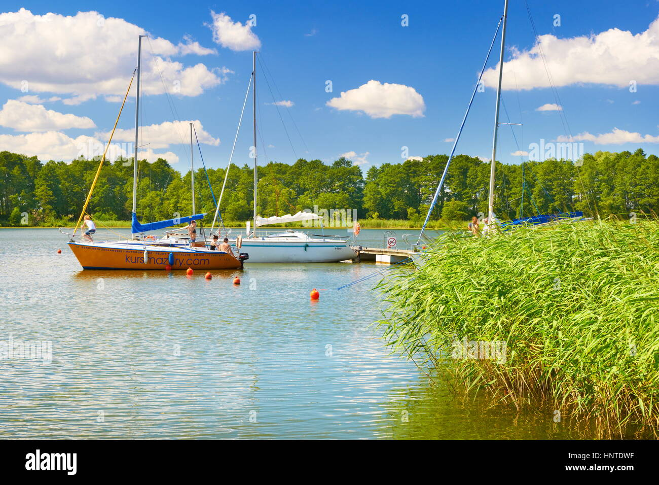 Sailboats at Sztynort Lake, Masuria region, Poland, Europe - Stock Image