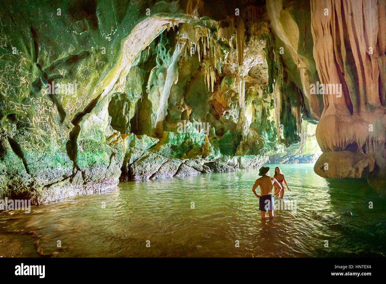 Tourists exploring Ko Talabeng Cave, Krabi Province, Thailand - Stock Image