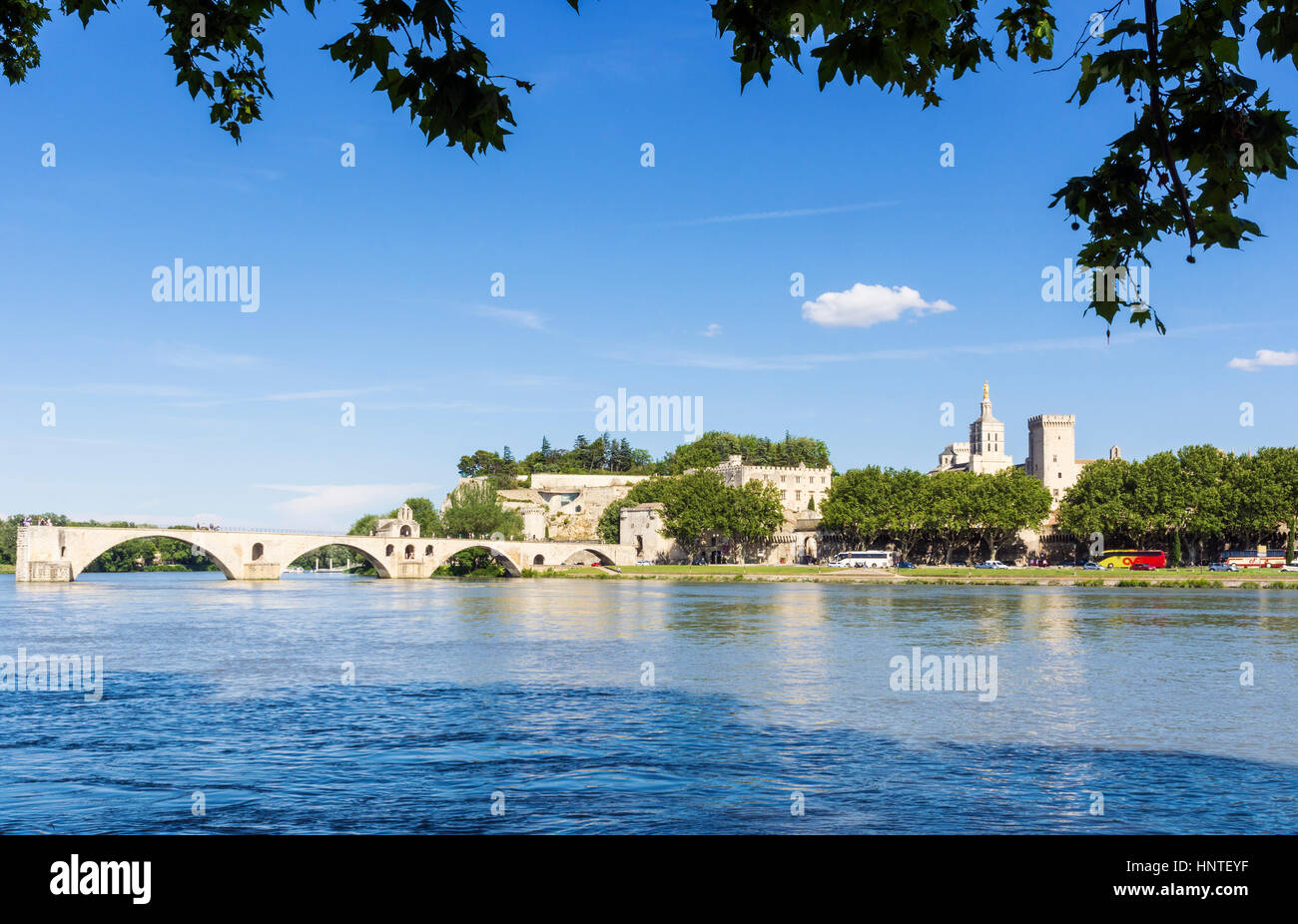 Avignon city skyline and Pont Saint-Bénézet bridge from the Rhone River, Avignon, France - Stock Image