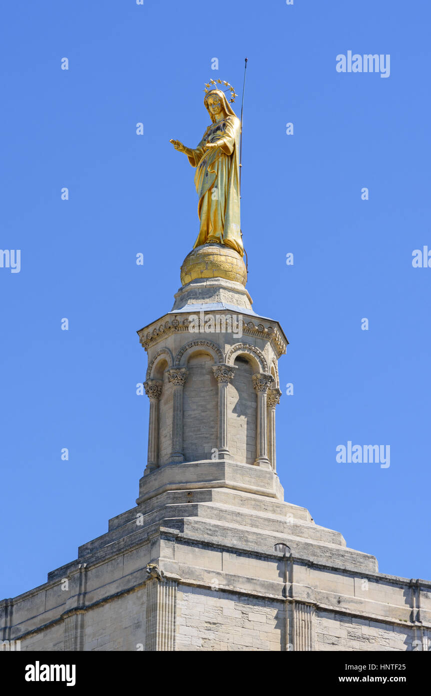 Gilded statue of the Virgin Mary atop the bell tower of the Roman Catholic Avignon Cathedral, Avignon, France - Stock Image