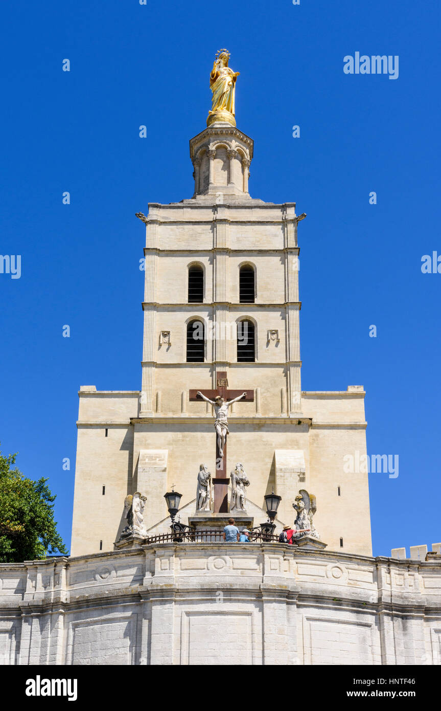 Forecourt and facade of the Roman Catholic Avignon Cathedral with gilded statue of the Virgin Mary atop the bell - Stock Image