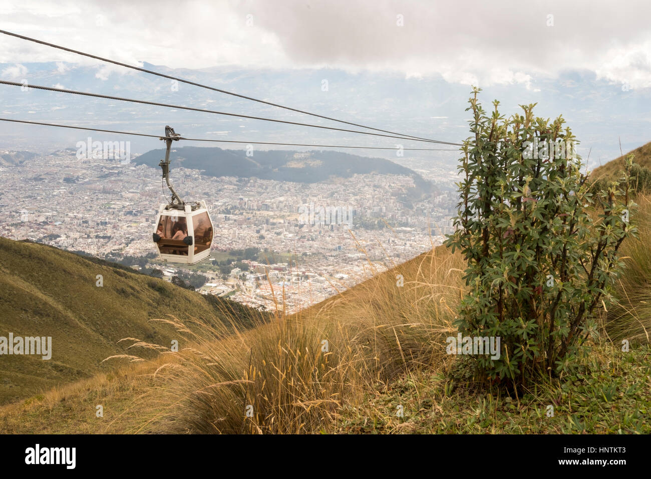 The TelefériQo in Quito, Ecuador, running from the edge of the city up the east side of Pichincha Volcano.View - Stock Image