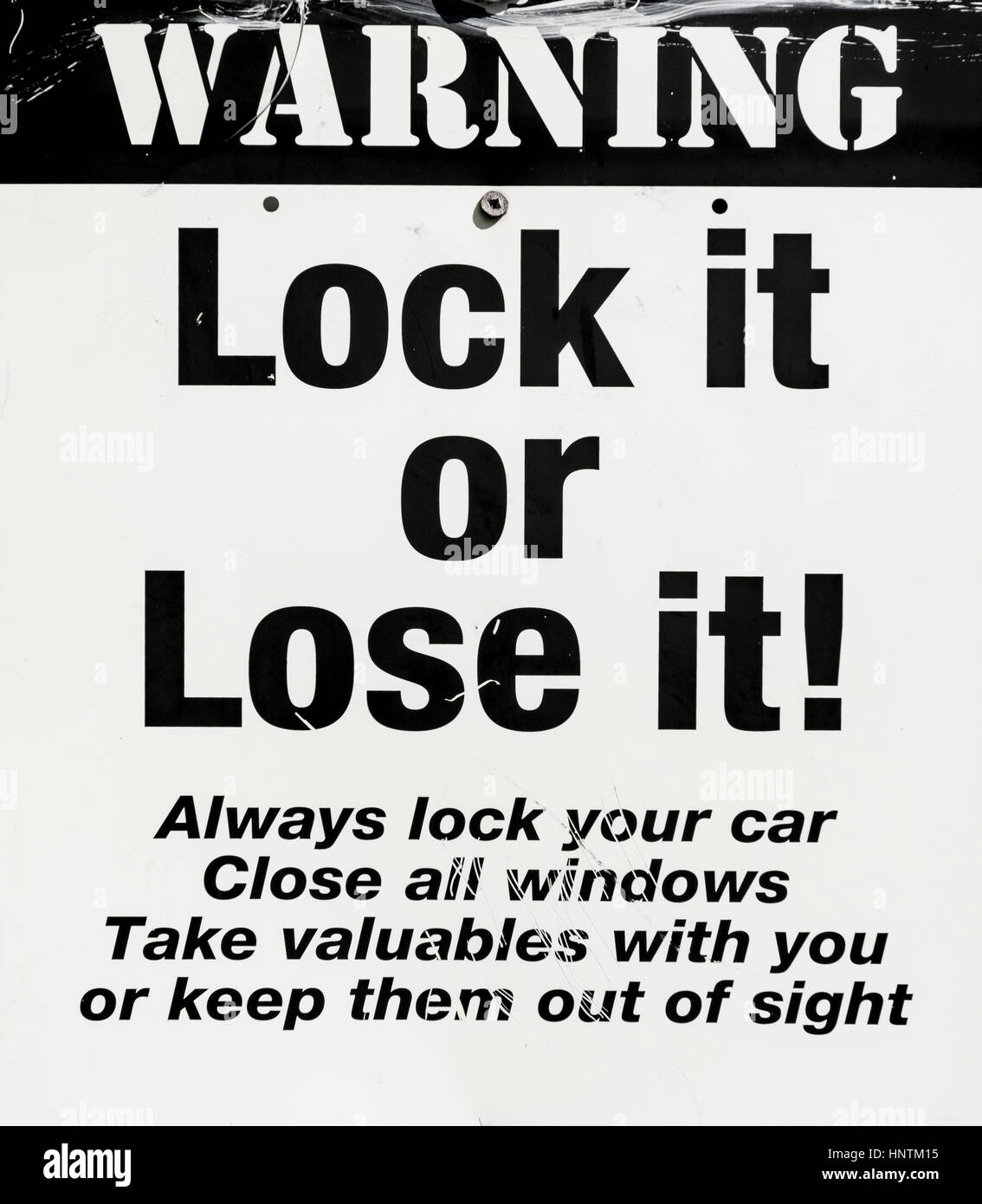 Warning Sign, Lock it or Lose it, car theft, warning against thieves, New Zealand - Stock Image