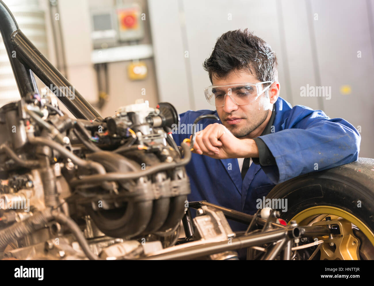 Mechanic working on a car engine - Stock Image
