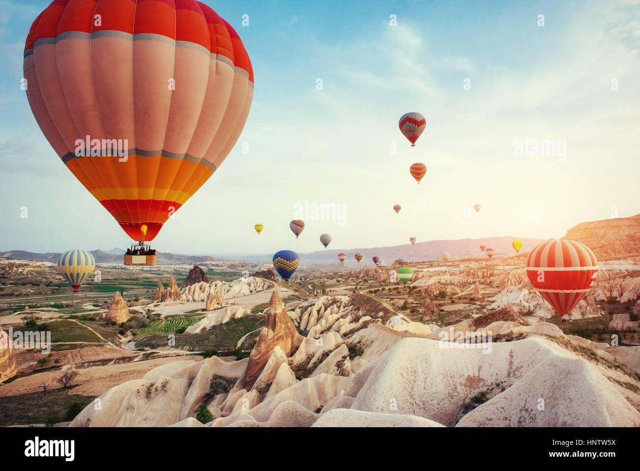 Turkey Cappadocia beautiful balloons flight stone landscape - Stock Image