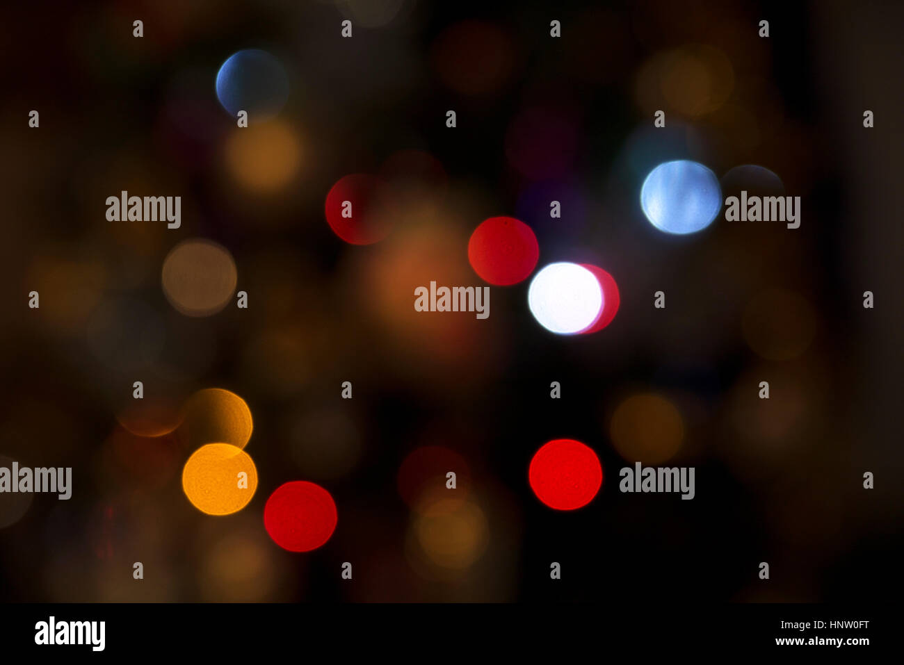 abstruct unfocused red orange blue green and yellow circle lights - Stock Image