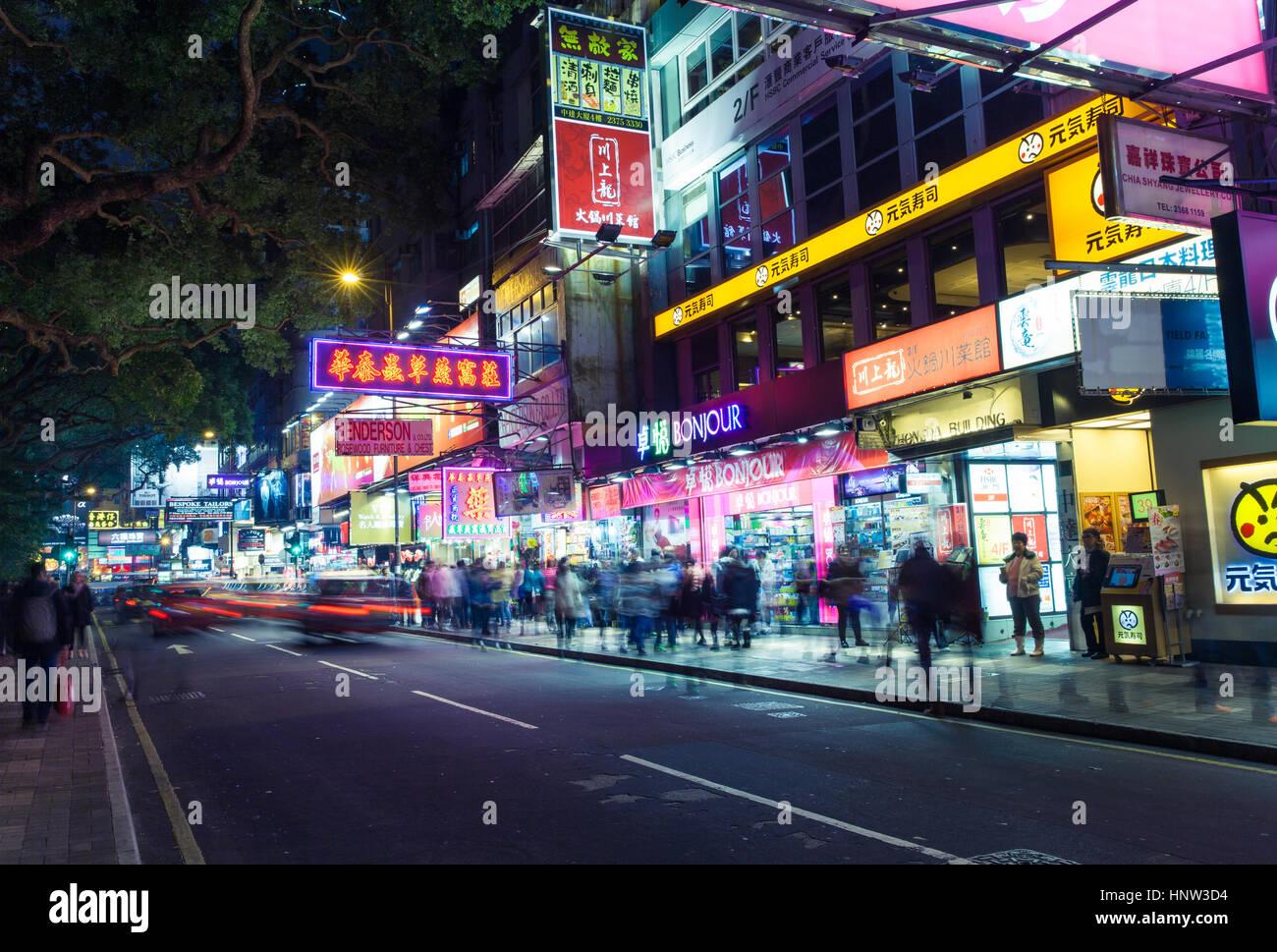 Hong Kong, Hong Kong SAR China - 16 February 2014: Crowds of people walking down Haiphong road on February 16, 2014, - Stock Image