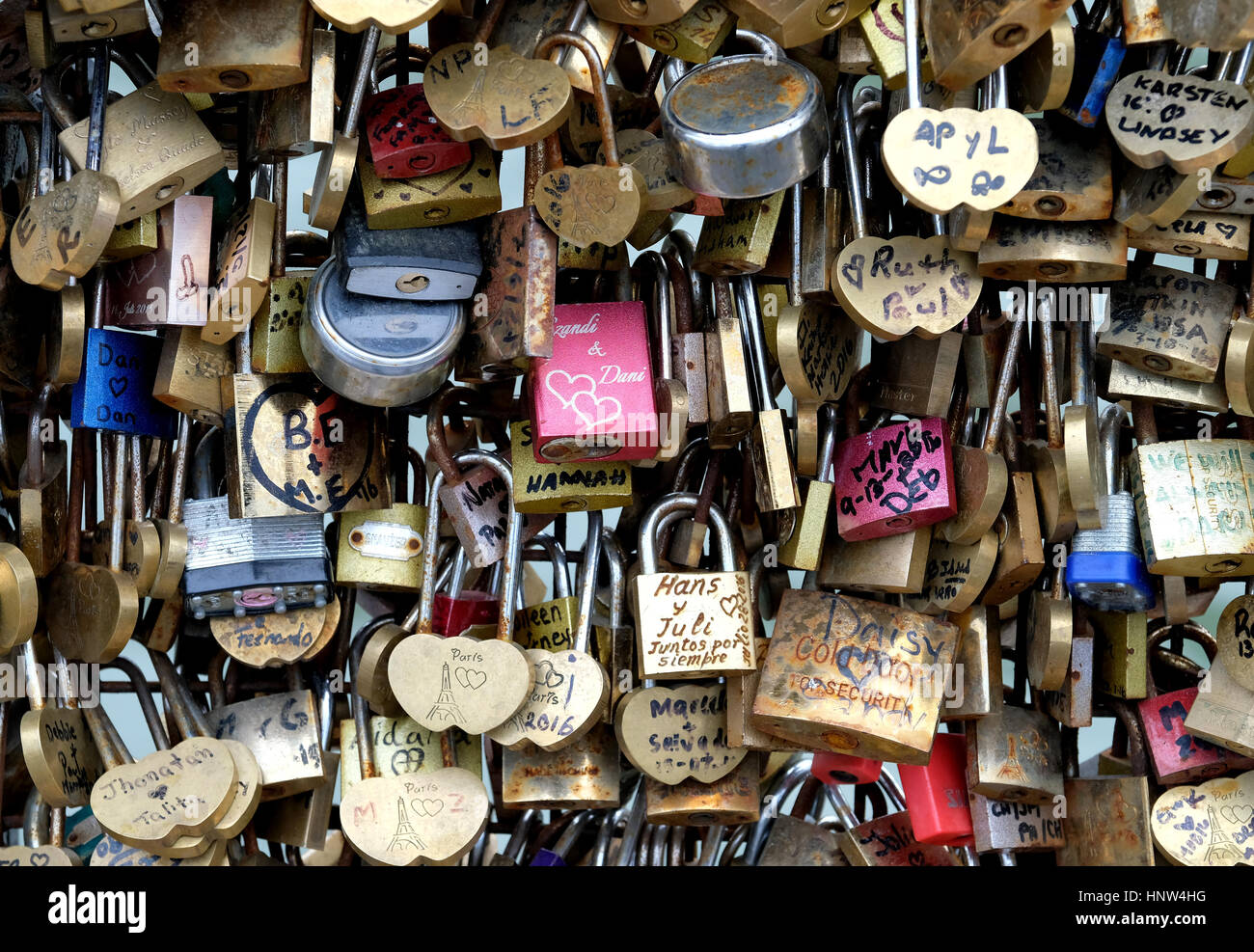 A young couple take a selfie at the Pont Neuf, Paris - Stock Image