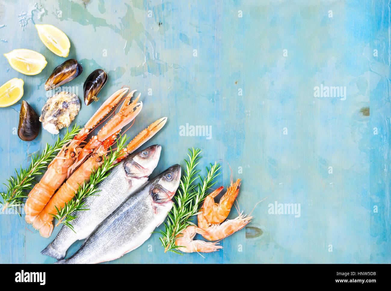 Fresh seafood on blue background - Stock Image