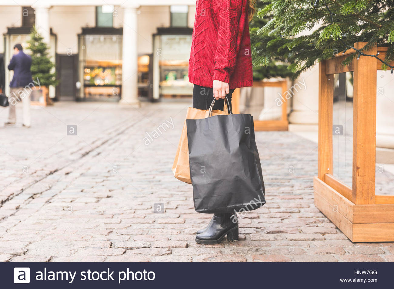 Shopper with shopping bags, Covent Garden, London, UK - Stock Image
