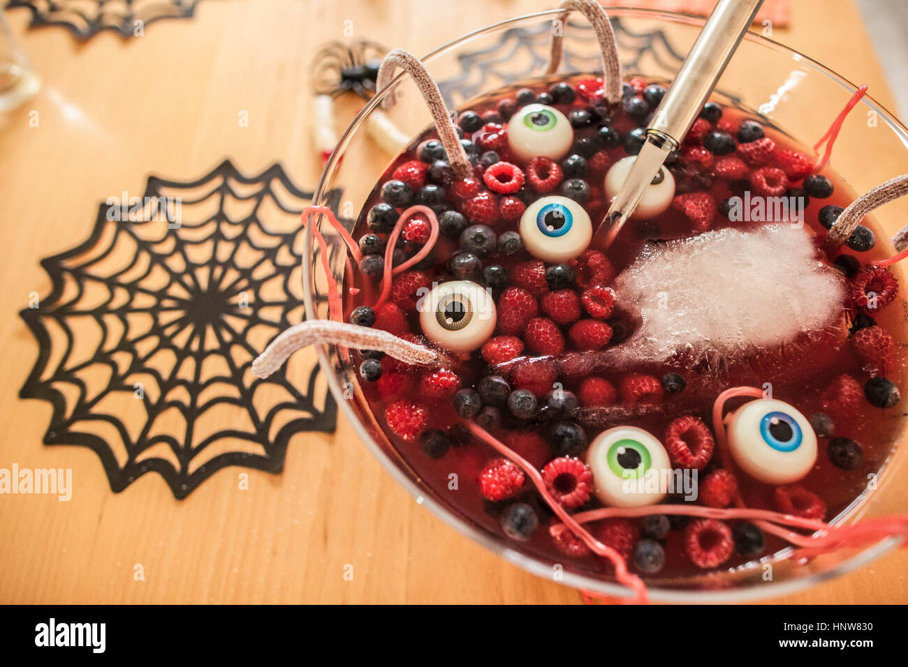 Halloween dessert with berries and floating eyeballs, close-up - Stock Image